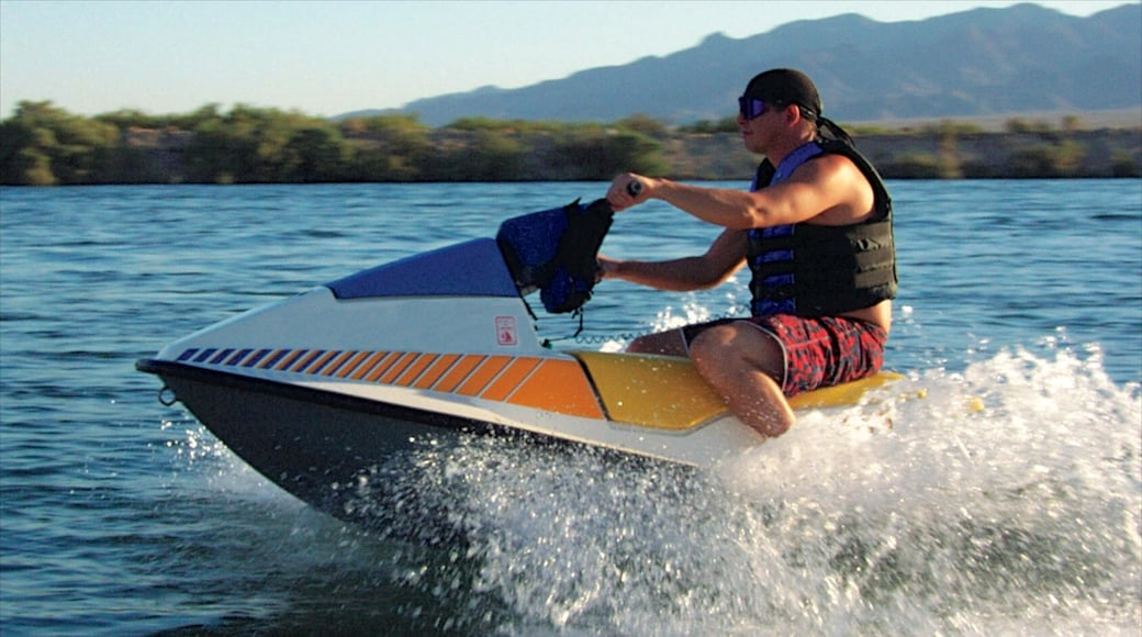 Bullhead City showing a lake or waterhole and jet skiing as well as an individual male