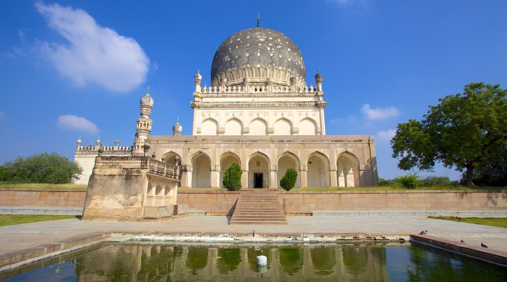 Qutub Shahi Tombs which includes heritage architecture, a temple or place of worship and a pond