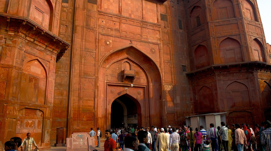 Red Fort which includes a castle and heritage architecture as well as a large group of people
