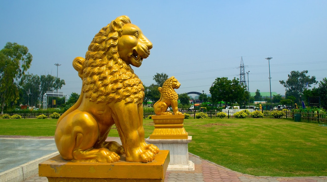 Shanti Vana which includes a statue or sculpture, a park and religious elements