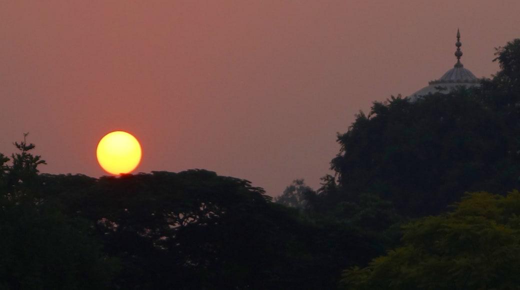 Taj Mahal featuring a sunset