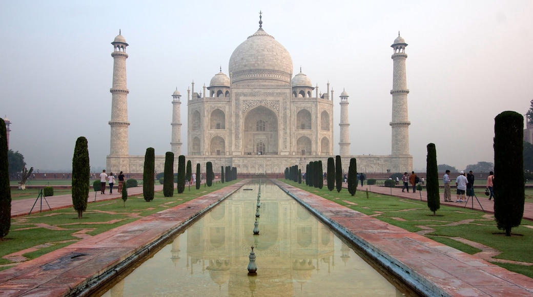 Taj Mahal featuring heritage architecture, a monument and mist or fog