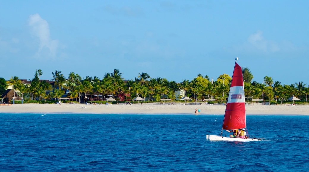 Turks and Caicos which includes tropical scenes, a coastal town and sailing