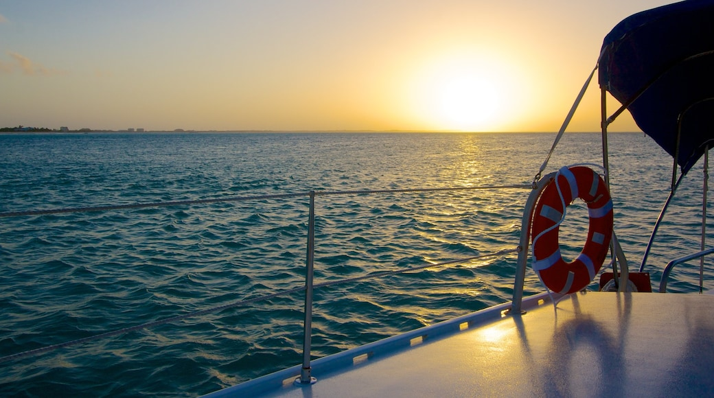 Providenciales showing a sunset and boating