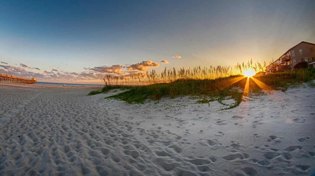Morehead City showing a sunset and a beach