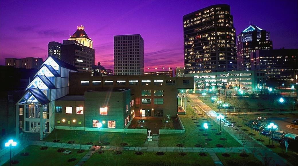 Greensboro which includes modern architecture, night scenes and a city