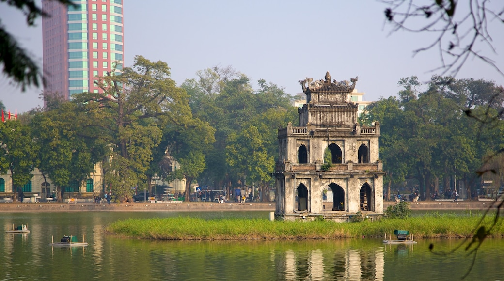 Hoan Kiem Lake which includes a lake or waterhole, heritage architecture and a monument