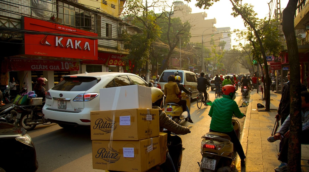 Hanoi featuring signage, motorbike riding and street scenes