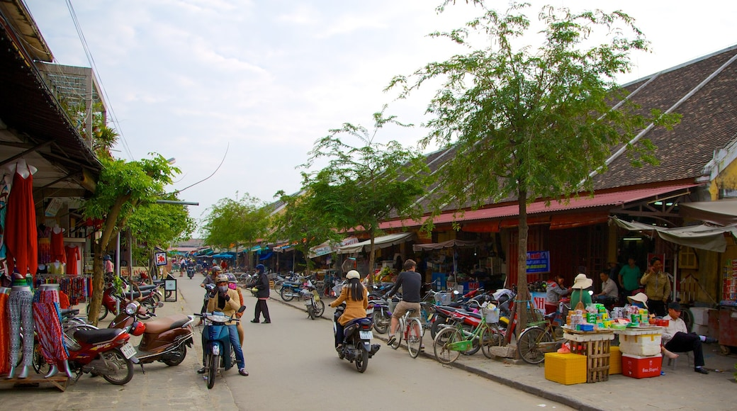 Hoi An City Centre featuring motorbike riding, street scenes and markets
