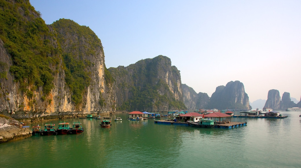Halong Bay featuring a coastal town, rocky coastline and a bay or harbour