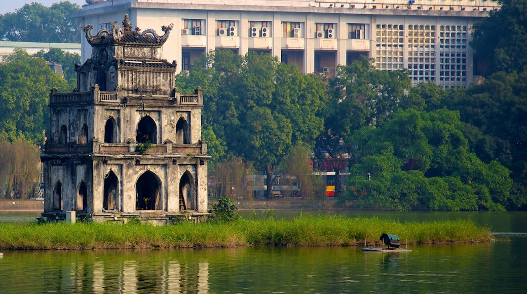 Hoan Kiem Lake featuring heritage architecture, a monument and a lake or waterhole