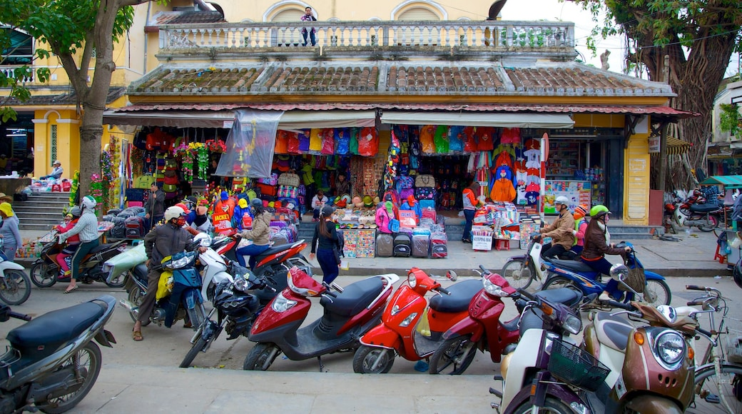 Hoi An City Centre showing motorbike riding, street scenes and markets