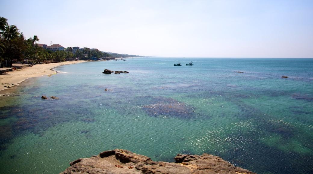 Dinh Cau Temple showing landscape views, rocky coastline and a sandy beach