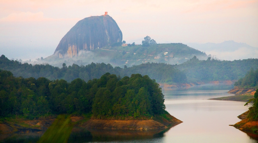 Rock of Guatape showing mountains, tranquil scenes and a river or creek