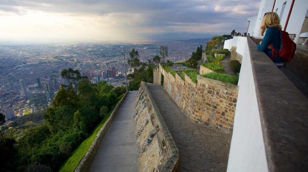 Monserrate featuring a city and views as well as an individual female