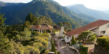 Monserrate showing a house, mountains and landscape views