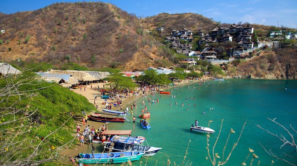 Taganga Beach showing a sandy beach, a bay or harbour and a coastal town