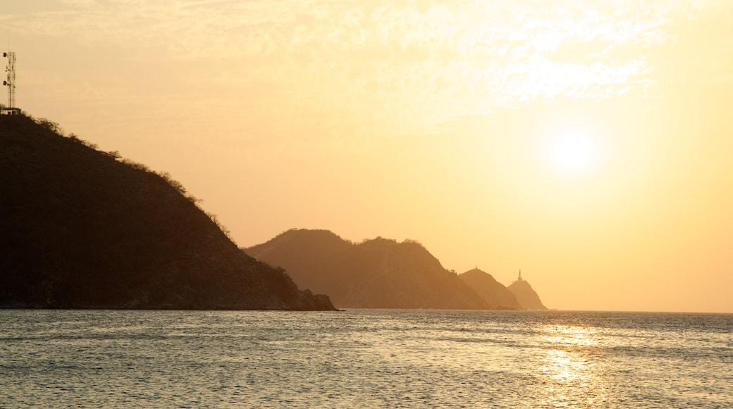 Taganga Beach showing landscape views, general coastal views and a sunset