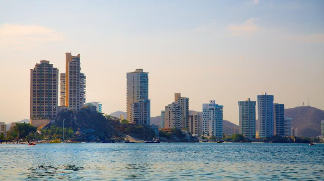 Rodadero Beach which includes a coastal town, a high rise building and general coastal views
