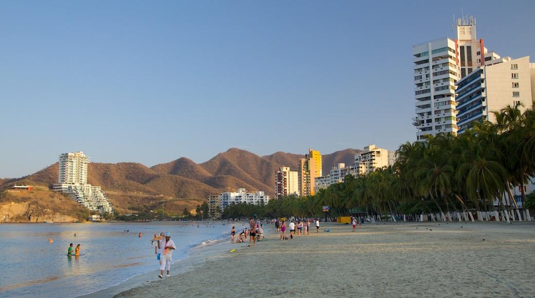Rodadero Beach showing a hotel, a sandy beach and a coastal town