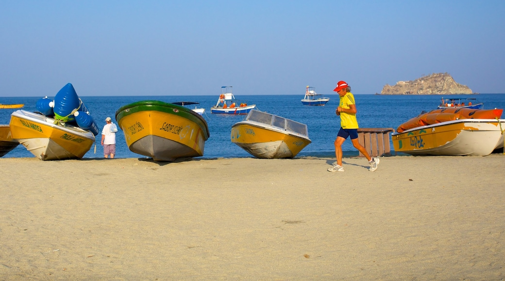 Rodadero Beach featuring boating and a beach as well as an individual male