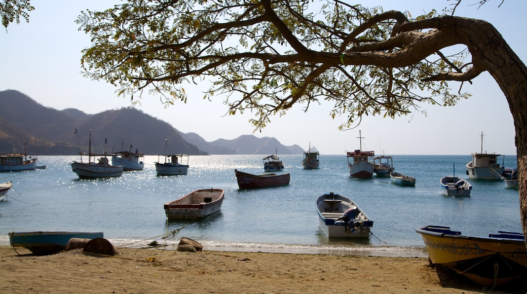 Taganga Beach featuring a beach, a bay or harbor and boating