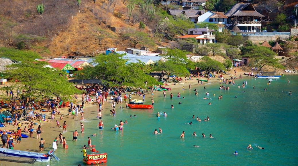 Taganga Beach showing swimming, a sandy beach and a coastal town