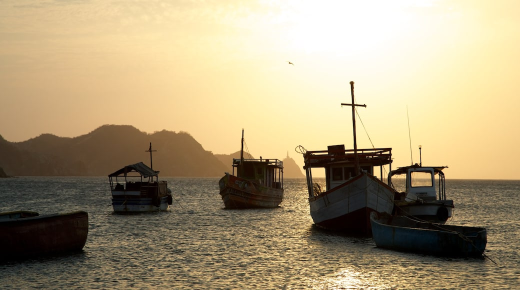 Taganga Beach which includes a sunset, boating and a bay or harbor