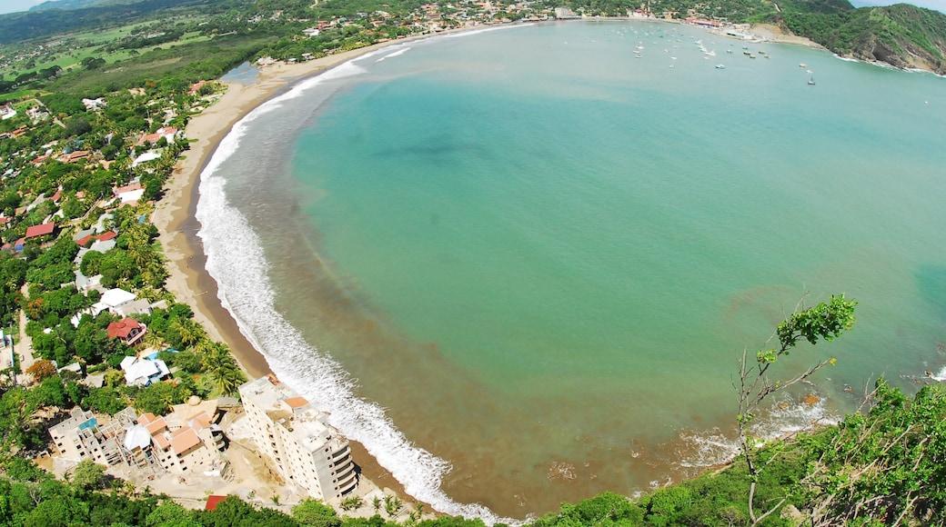 San Juan del Sur featuring a coastal town, a beach and tropical scenes