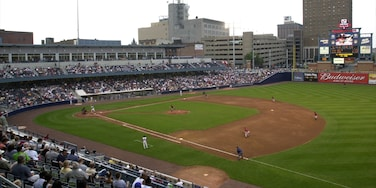 Toledo featuring a sporting event as well as a large group of people