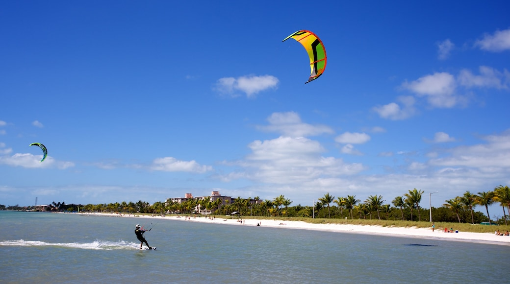 Smathers Beach showing kite surfing and a beach as well as an individual male