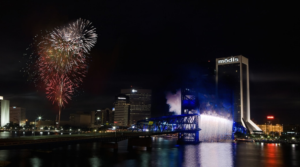 Downtown Jacksonville which includes night scenes, a city and a bridge