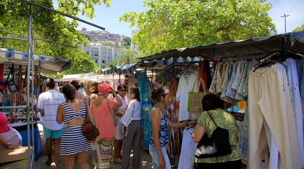 Ipanema which includes markets as well as a large group of people