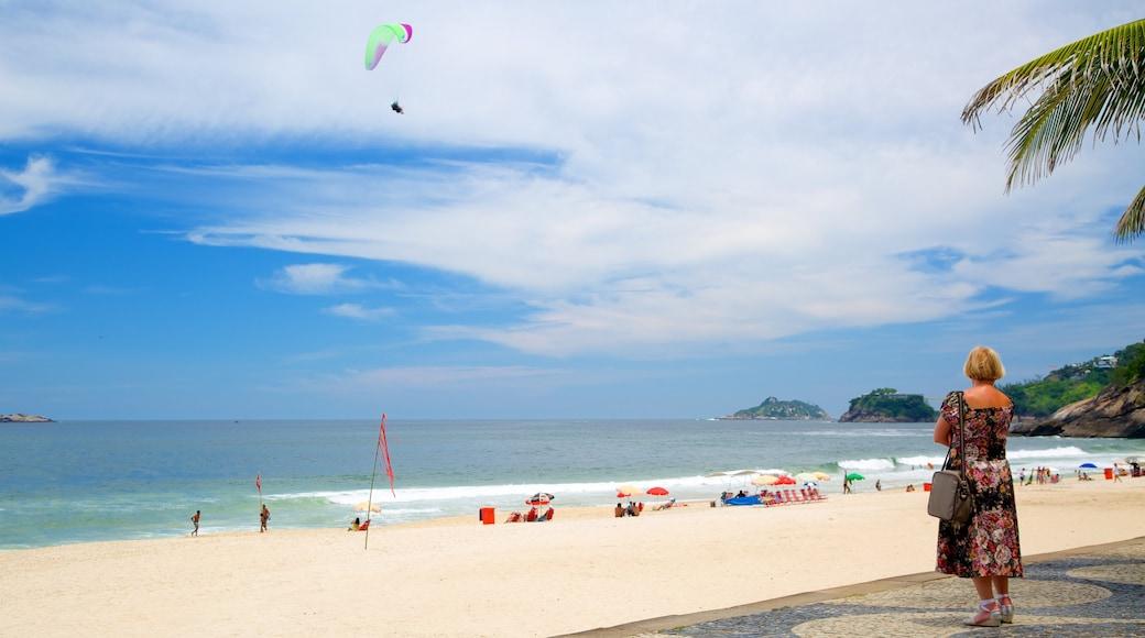 Sao Conrado Beach which includes a sandy beach as well as an individual femail