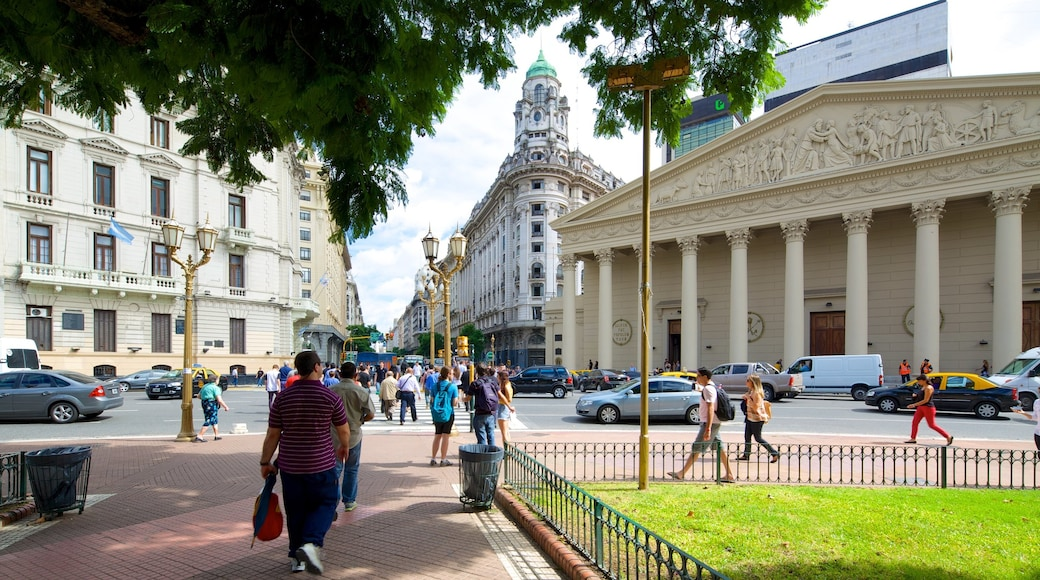 Buenos Aires Metropolitan Cathedral featuring heritage architecture as well as a large group of people