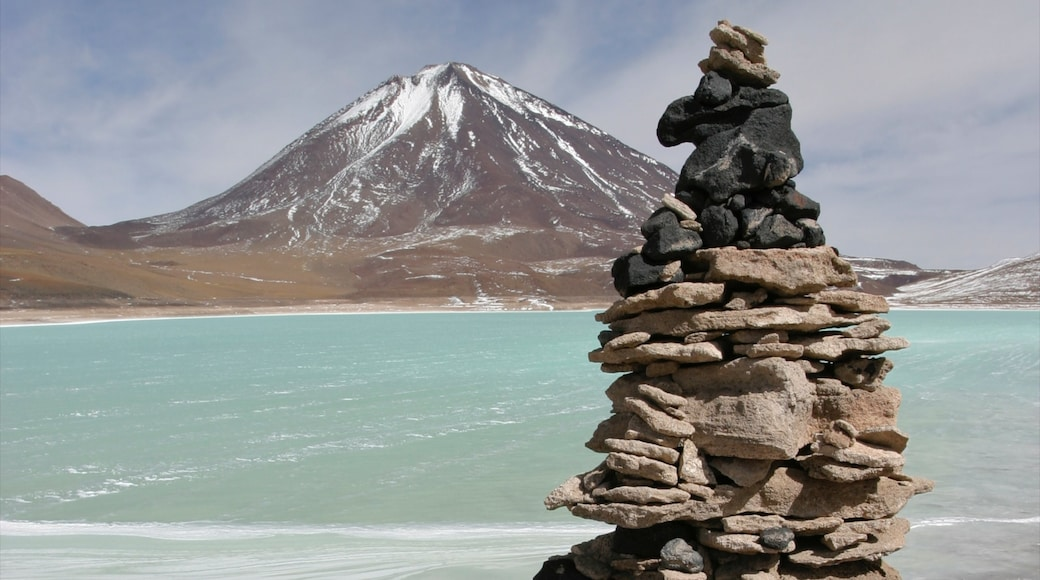 Bolivia featuring a lake or waterhole, snow and mountains