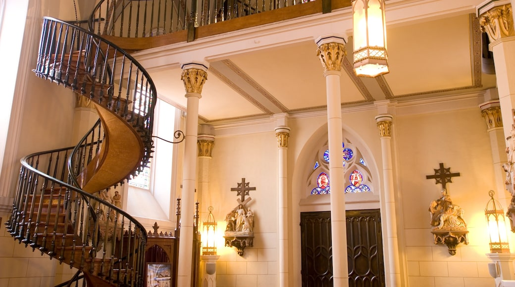Loretto Chapel featuring religious aspects, a church or cathedral and interior views