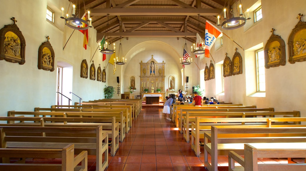 Mission San Rafael Arcangel featuring religious elements, a church or cathedral and interior views
