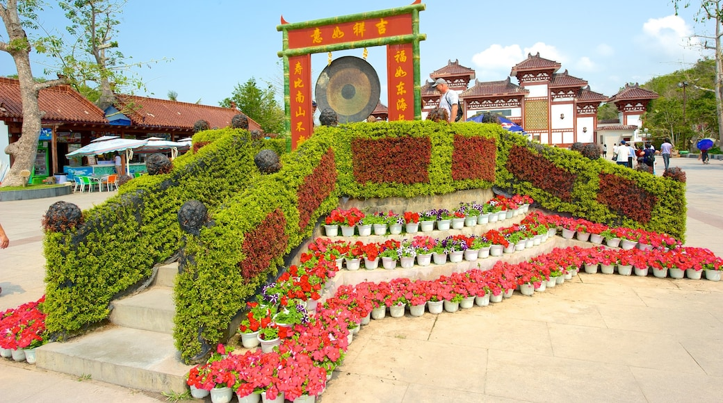 Guanyin Statue of Hainan which includes a monument, flowers and a square or plaza