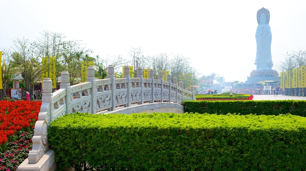 Guanyin Statue of Hainan featuring a park and a bridge