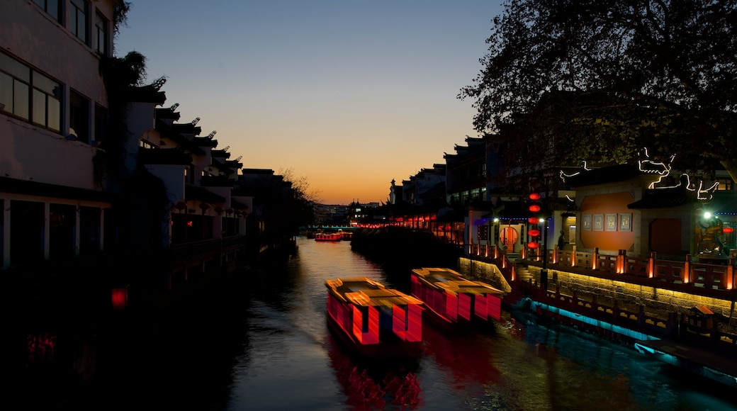 Nanjing showing night scenes, a river or creek and a sunset