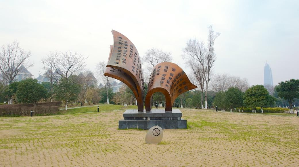 Jinji Lake featuring outdoor art and a garden