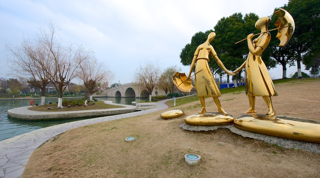 Jinji Lake which includes a garden, a lake or waterhole and outdoor art
