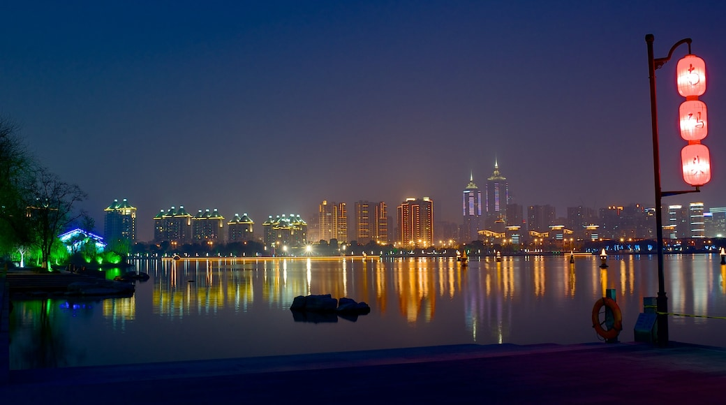 Jinji Lake which includes a river or creek, a city and night scenes