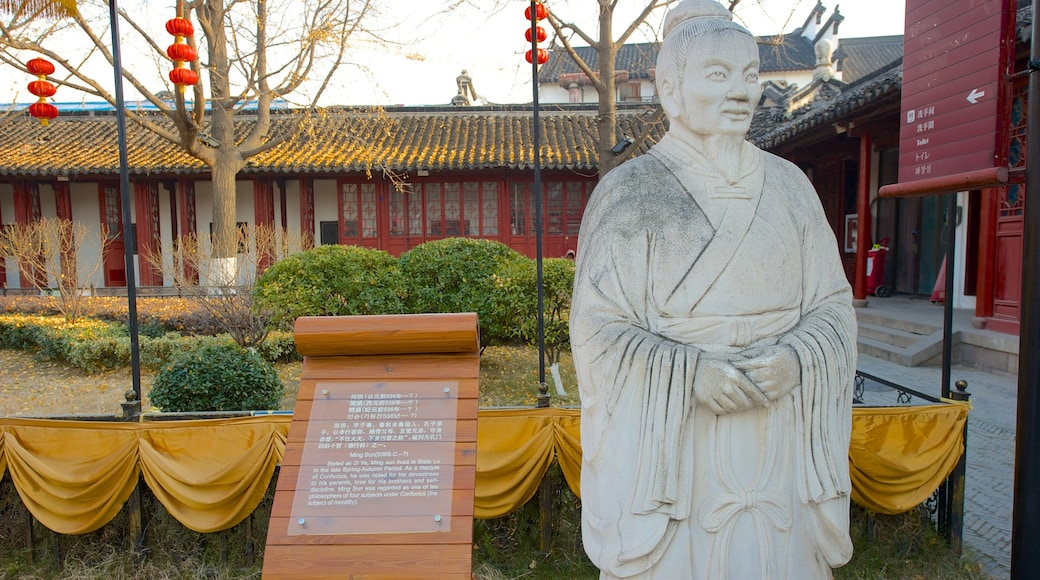 Temple of Confucius which includes a statue or sculpture and signage