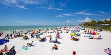 Fort Myers Beach featuring a sandy beach as well as a large group of people