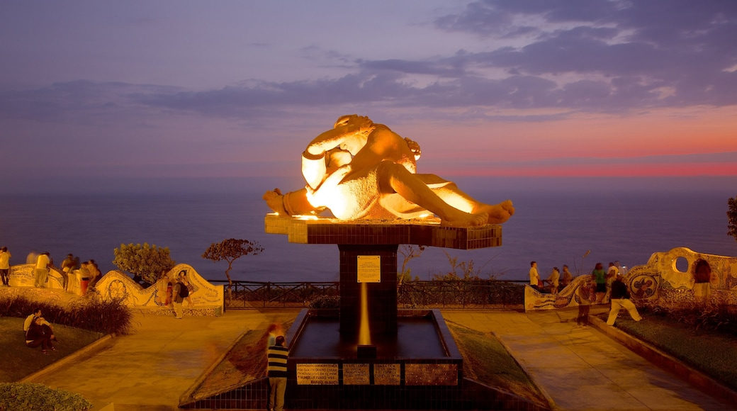 Parque del Amor which includes night scenes, outdoor art and a sunset