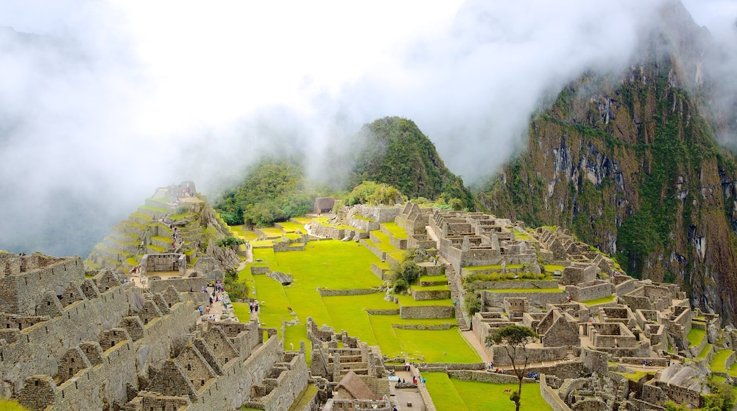 Machu Picchu featuring building ruins and mist or fog