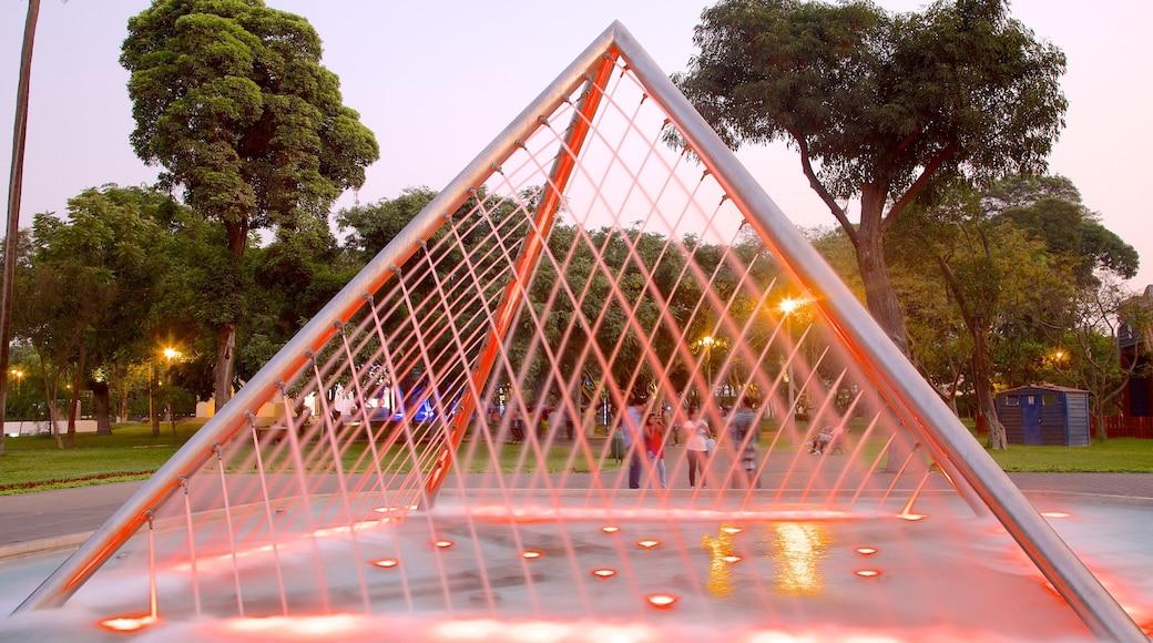 Parque de Exposiciones que incluye un parque y una fuente
