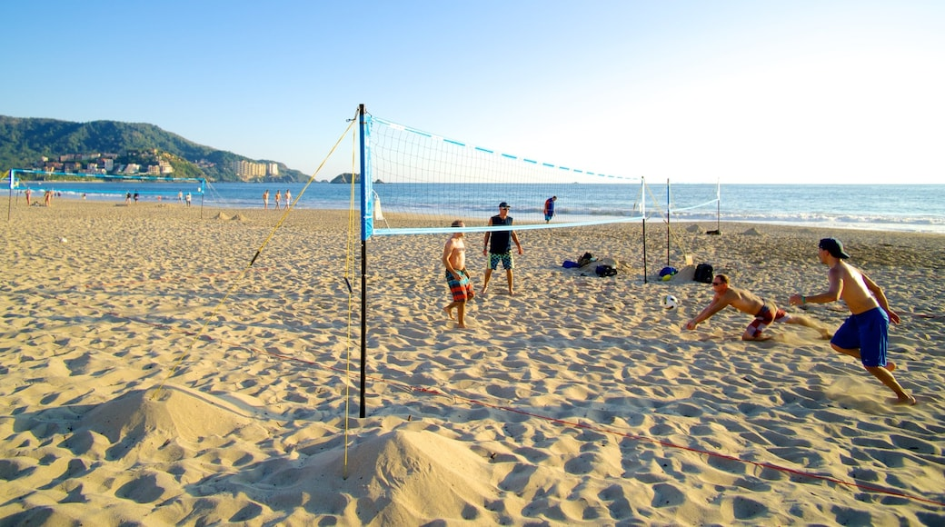 El Palmar Beach showing a beach and general coastal views as well as a small group of people
